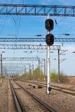 El ferrocarril y señala un semáforo Fotos de archivo libres de regalías
