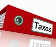 El fichero de impuestos contiene informes y documentos de los impuestos Foto de archivo libre de regalías