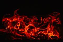 El flamear en un fondo oscuro Imagen de archivo libre de regalías