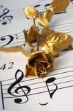 El flover y la nota del oro Fotos de archivo libres de regalías