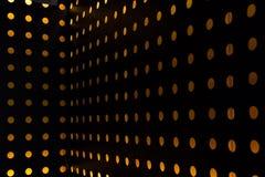 El fondo anaranjado de la luz del círculo adornó la pared Imágenes de archivo libres de regalías