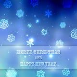 El fondo borroso azul del Año Nuevo con los copos de nieve con el texto casa la Navidad y la Feliz Año Nuevo Imagen de archivo libre de regalías
