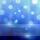 El fondo borroso azul del Año Nuevo con los copos de nieve con el texto casa la Navidad y la Feliz Año Nuevo Fotografía de archivo libre de regalías