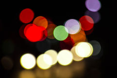 El fondo borroso las luces del bokeh a partir de la noche de la Navidad va de fiesta para y foto de archivo libre de regalías