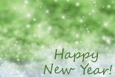 El fondo chispeante verde de la Navidad, nieve, manda un SMS a Feliz Año Nuevo Imagenes de archivo