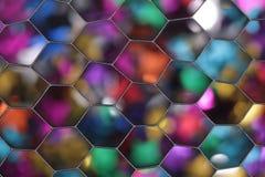 El fondo colorido del bokeh fotografió a través de un difusor de la rejilla del panal imágenes de archivo libres de regalías