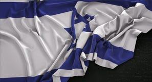 El fondo 3D de Israel Flag Wrinkled On Dark rinde Imagen de archivo libre de regalías