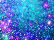 El fondo de brillar las estrellas coloridas en azul imagen de archivo libre de regalías