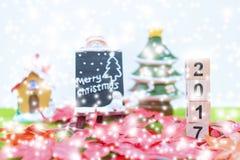 El fondo de la Feliz Navidad y numera 2017 t Imagenes de archivo