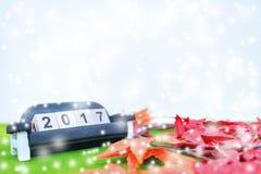 El fondo de la Feliz Navidad y numera 2017 t Imagen de archivo libre de regalías