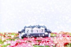 El fondo de la Feliz Navidad y numera 2017 t Foto de archivo