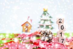 El fondo de la Feliz Navidad y numera 2017 t Foto de archivo libre de regalías