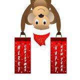 El fondo de la Navidad con un mono y un regalo empaquetan Imagen de archivo