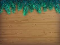 El fondo de la Navidad o del Año Nuevo con el abeto realista ramifica en una tabla marrón de madera Imagen de archivo libre de regalías