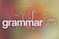 El fondo de la nube de la palabra del concepto de la gramática en pastel empañó backgrou Fotografía de archivo