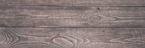 El fondo de la textura de madera sube con los remanente de la pintura rosada imagenes de archivo