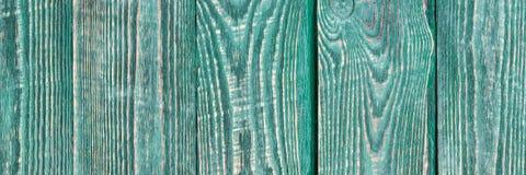 El fondo de la textura de madera sube con un resto de pintura del color verde natalia fotografía de archivo libre de regalías