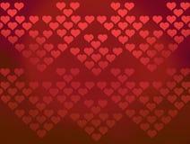 El fondo de los corazones de la tarjeta del día de San Valentín roja de los modelos Fotografía de archivo libre de regalías