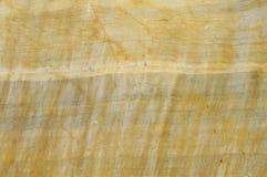El fondo de piedra amarillo Fotos de archivo libres de regalías