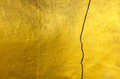 El fondo del amarillo de la textura de la pared del cemento Imagen de archivo libre de regalías
