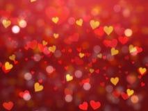 El fondo del día del ` s de la tarjeta del día de San Valentín con el bokeh en forma de corazón se enciende Imágenes de archivo libres de regalías