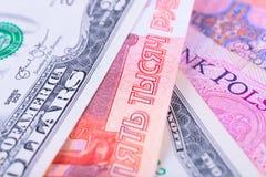 El fondo del dinero de los países diferentes: dólares, euros y rublos rusas Imágenes de archivo libres de regalías