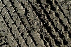 El fondo del fango de la pisada del neumático Imágenes de archivo libres de regalías