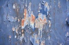 El fondo del hierro pintó la pintura azul con los rasguños de las grietas y el fondo del acero del moho foto de archivo