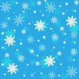 El fondo inconsútil del invierno con los copos de nieve blancos planos tuerce en espiral encendido Foto de archivo libre de regalías