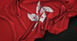 El fondo oscuro 3D de Hong Kong Flag Wrinkled On rinde ilustración del vector