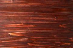 El fondo rayado texturizado de madera marrón Foto de archivo