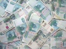 El fondo - son muchos billetes de banco de Rusia Imagenes de archivo