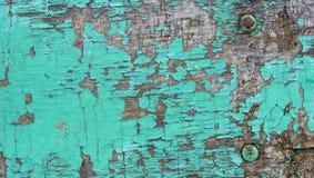 El fondo texturizado de madera rústico del viejo grunge con color verde agrietó la pintura y rasguños resistidos imagen de archivo