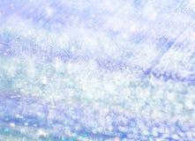 El fondo unfocused del agua azul iridiscente fotografía de archivo libre de regalías