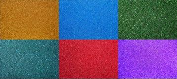 El fondo verde del fondo con el fondo ultramarino púrpura rojo de oro del mar del verde azul de las chispas con las chispas fijó  Imágenes de archivo libres de regalías