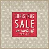 El fondo y la etiqueta beige de la Navidad con venta ofrecen, vector Fotos de archivo