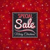 El fondo y la etiqueta rojos de la Navidad con venta ofrecen, vector Fotografía de archivo