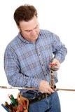 El fontanero repara el tubo Imagen de archivo