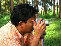 El fotógrafo ocupado Imagen de archivo libre de regalías