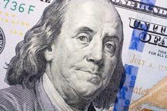 El fragmento del billete de dólar 100 Foto de archivo