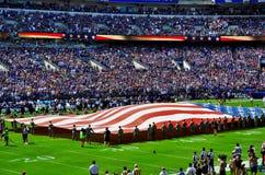 El fútbol de los cuervos paga tributo a 9/11 Imagenes de archivo