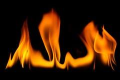 El fuego flamea el fondo fotografía de archivo