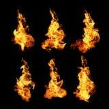 El fuego flamea la colección aislada en fondo negro fotos de archivo