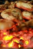 El fuego hizo la cena Imagen de archivo