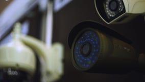El funcionamiento de la cámara de seguridad del CCTV existencias Cámaras de vigilancia video almacen de metraje de vídeo
