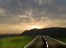 El futuro bajo un cielo de la puesta del sol Imagen de archivo libre de regalías