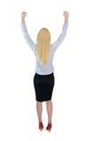 El ganador de la mujer de negocios da para arriba Foto de archivo