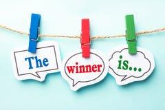 El ganador es? mage del colorfull de un podium Fotos de archivo libres de regalías