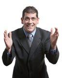 El gesticular del hombre de negocios Foto de archivo