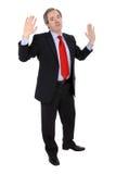 El gesticular del hombre de negocios maduros Imágenes de archivo libres de regalías
